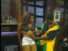 Busty ebony babe fucked in this vintage porn video