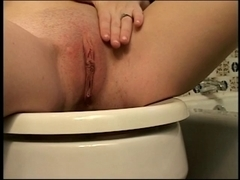 Sexually Excited brunette hair with navel ring and puffy nipps makes a golden urine stream