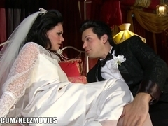 Brunette bride in stockings crammed on the bed