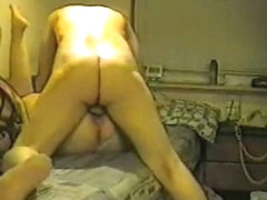 Older couple action of love at home