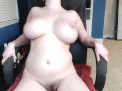 Hot babe sucking her tits and masturbating on cam