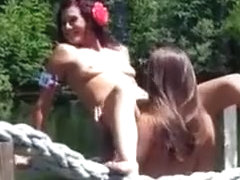 Two babes fool around at outdoor music festival