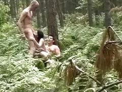 Curvy fairy penetrated in the forest by two nudist men