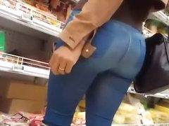 Long hair blonde in tight jeans pants and boots