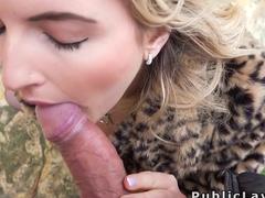 Blue eyed blonde sucks cock outdoors