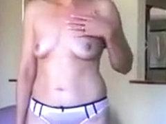 Lingerie-clad amateur mom doing striptease