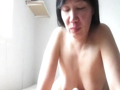 Shaven Asian Handled With a Stiff Dick