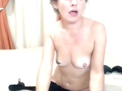ErotiqAdelle plays with a white vibrator