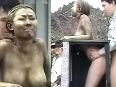 Golden Japanese statue penetrated from the behind