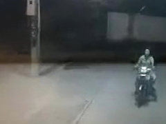Female motorcyclist gets caught on security cam urinating