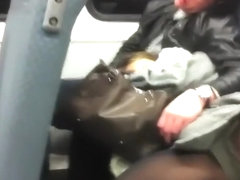 Relaxed girl spreads legs in the train