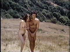 Classical nude couple have fun in public beach