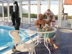 Nurse sees to patient by the Pool