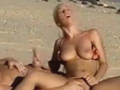 Blonde bimbo makes a hot manual stimulation at the beach