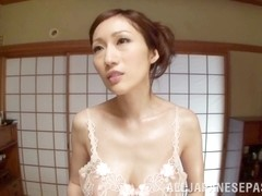 Arousing Japanese mature babe Julia gives a foot job and tit fuck