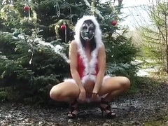Exhibitionist woman in sexy Christmas outfit