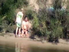 Voyeur tapes a couple having sex in public on the side of the river
