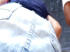 Checking out her hairy pussy under the denim skirt
