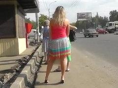 Fake blonde woman wears red panties