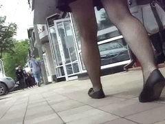Sexy ladies in black skirts filmed outdoors in the upskirt action