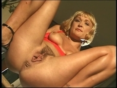 Hawt short hair blond on table fingering slit stoops and voids urine