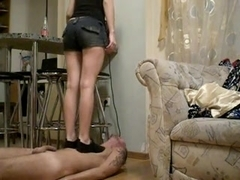 Buxom blonde steps on her sissy serf