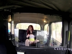 Busty redhead gets tits fucked in fake taxi