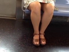 Candid legs and toes on train