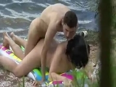 Voyeur tapes public beach fuck