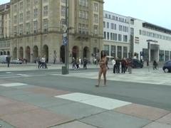 Long haired brunette walks naked in public in hd movie