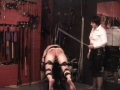 Sissy thrall gets caned hard in a true BDSM style