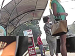 Blonde waits for a bus in the upskirt outdoor scene