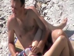 Sexually Lustful couple posing on the beach