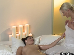 Oiled masseuse tribbing brunette babe