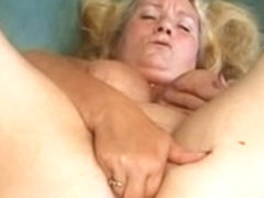 chunky blond granny disrobes and masturbates with cell phone