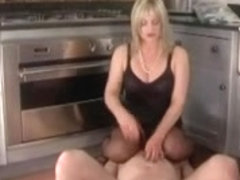 Femdom Corselette and Nylons Femdom-Goddess Spanks in the Kitchen