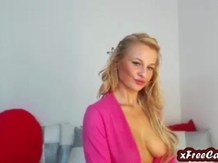 Blonde busty milf fingers and rubs her pussy