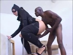 catwoman and large dark strapon