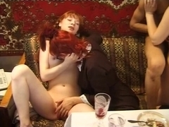 Redhead receives cumshots and double penetration sex