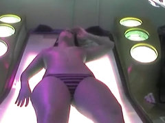 Hot babes enjoy tanning in the solarium while being naked