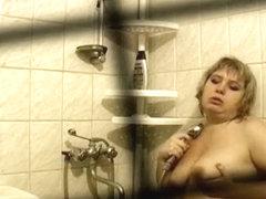 Fat woman in bathtub masturbating and shower