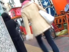 Asian girl got skirt sharked on her bicycle with people near