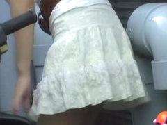 Asian cutie on a bike got really wet by a guy sharking video