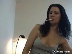 Brunette slut riding cock while smoking