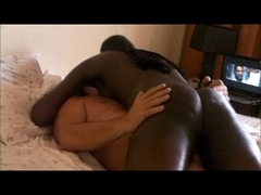French ebony girl riding an older white cock on the bed