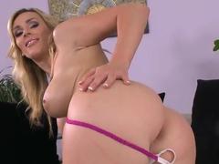 Curvy blonde milf Tanya Tate teases in living room