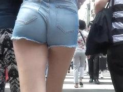 Smoking hot brunette gets her big butt caught on tape