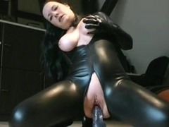 Slut wears latex while fucking a dildo