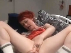 Solo red haired hottie playing at home