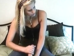 Hot blond hottie sucks on a rigid pecker.